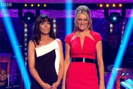 Tess Daly successfully negotiates her way through a tea towel holder