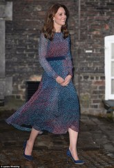 YES! Kate Middleton creates the illusion of curves by adding a belt to this LK Bennett dress