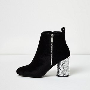 Black velvet boots reduced to £30 at River Island